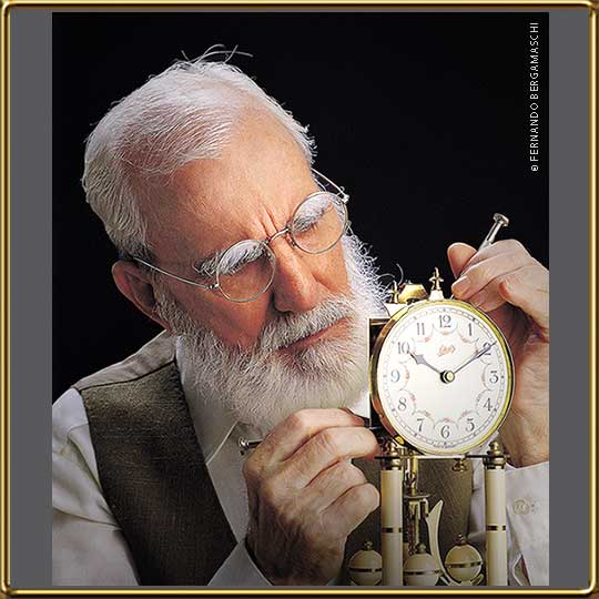 Old man fixing old watch